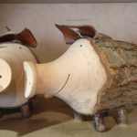 Piggy banks carved from a tree branch