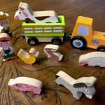 nine wooden farm pieces to play with