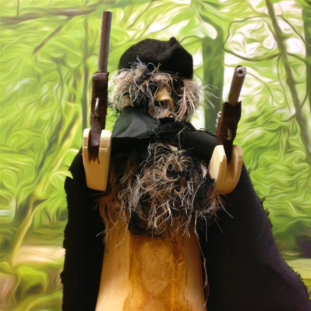 Locally made wooden figurine of a Highwayman