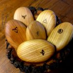 A selection of Engraved wooden pebbles